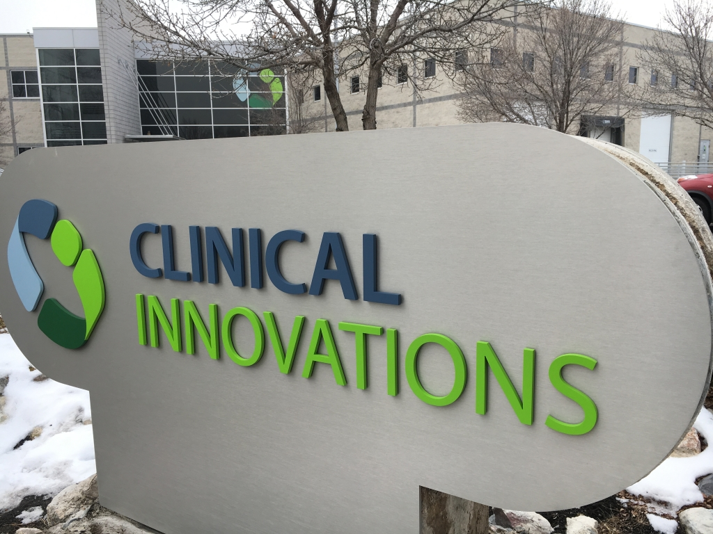Clinical Innovations Sign in Front of Building